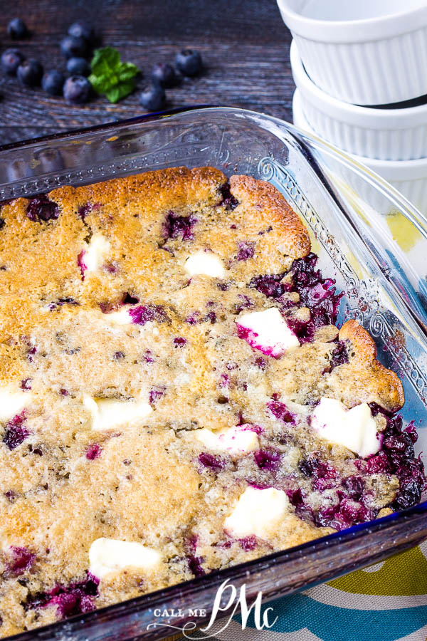Blueberry Cream Cheese Dump Cake has got to be the easiest cake in the world to make. Fresh blueberries sit on the bottom with chunks of cream cheese scattered throughout. #cake #cobbler #blueberries #cream #creamcheese #recipe #dessert #callmepmc