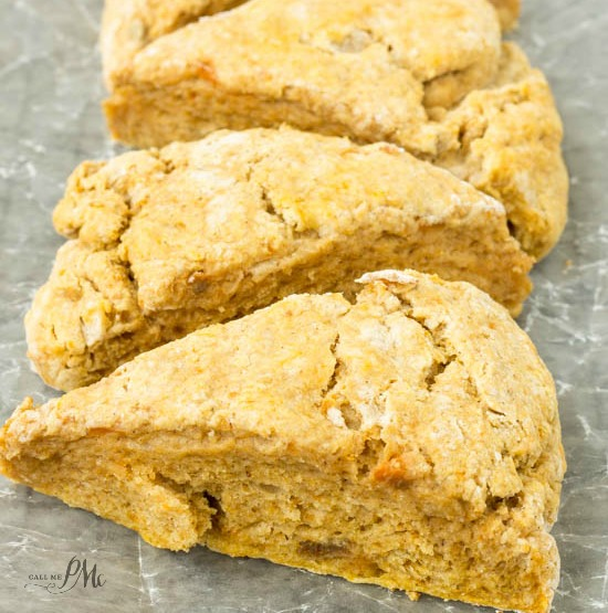From callmepmc.com, Easiest Pumpkin Scones recipe are soft and fluffy on the inside with crispy, crumbly edges