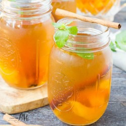 Peach Cobbler Moonshine recipe is a tasty peach cocktail with cinnamon & two different alcohols. Perfect for football games & hunting season. #tailgating #peach #moonshine #cocktails #recipe #alcohol #freshpeaches #homemade #Everclear #howtomake #fresh #cocktailsrecipe #cocktailsdrinks