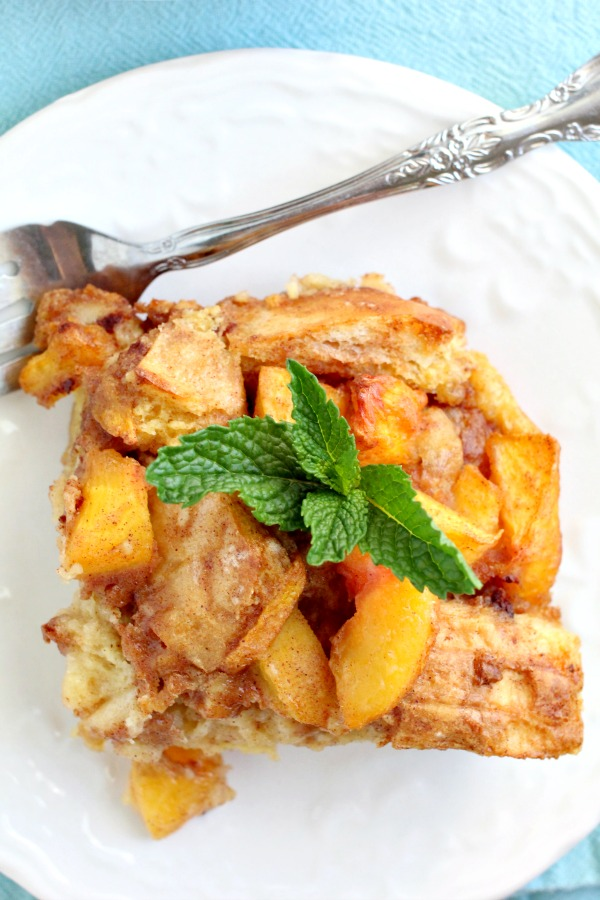 Amazingly delicious, Easy Peach Cobbler Bread Pudding is full of fresh peaches, rich custard, and a hint of rum! #breadpudding #dessert #dessertrecipes #callmepmc #recipes