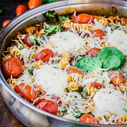 One Pan Spinach Cheese and Fire Roasted Tomato Pasta is just plain good eatin'! Pasta and cheese, the epitome of comfort food.