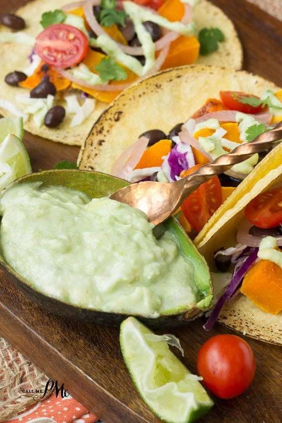 Black Bean Butternut Squash Tacos with avocado cream sauce recipe is one filling meatless main meal!