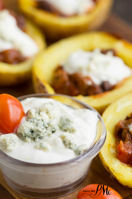 Chili Stuffed Potato Skins with Blue Cheese Greek Yogurt Dressing RECIPE are baked to extra crispy and filled with hearty chili and topped with a tangy blue cheese sauce
