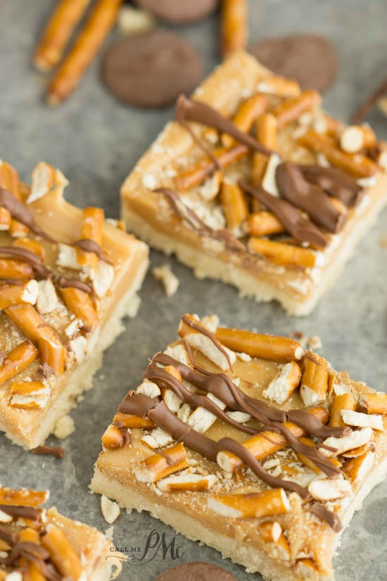 Crunchy Millionaire's Shortbread recipe - buttery shortbread is topped with caramel, crushed pretzels and dark chocolate.