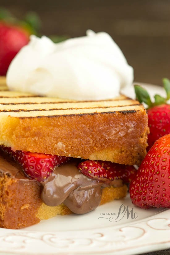 Nutella Strawberry Grilled Pound Cake Sandwiches recipe - Creamy chocolate hazelnut spread and fresh strawberries are the center of this pound cake panini.