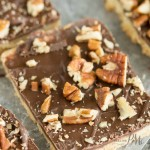 Chocolate Pecan Shortbread Bars recipe has a buttery shortbread crust and topped simply with luscious chocolate and salted pecans. #pecans #recipe #dessert #snack #cookie #bars #easy #recipes #shortbread