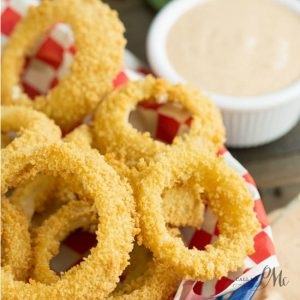 Oven Fried Onion Rings with Copycat Outback Blooming Onion Dipping Sauce. Healthier onion rings are crispy, crunchy, and paired with an amazing spicy sauce for dunking!