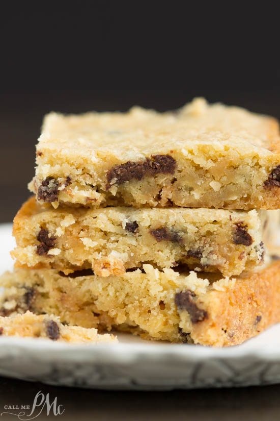 Congo Squares or pan cookie bars have a buttery and chewy texture. They are thick and chocked full of rich, semi-sweet chocolate chips, pecans, and coconut. #bars #cookies #baked #fromscratch #chocolatechips