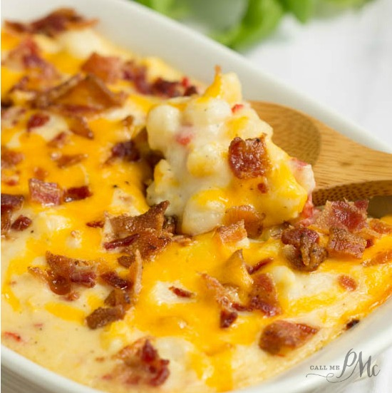 This Hominy Au Gratin casserole recipe is easy to make and super creamy. Hominy Au Gratin is an old fashioned southern staple that is a tasty and filling cheese and bacon topped side dish. Comfort food at it's best.