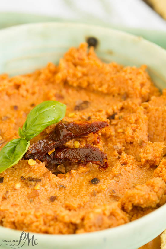 Sun Dried Tomato Hummus Recipe is creamy, spicy, and has a nice earthy flavor from the sun-dried tomatoes.