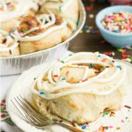 Tender and fluffy Birthday Cake Cinnamon Rolls are Fun, festive, easy to make, and they taste heavenly! This recipe is definitely one you want to have on your breakfast roster!