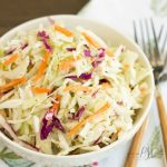 A basic cole slaw recipe, Tangy Vinegar Based Slaw is zippy and crunchy flavored with a little heat and a pinch of sweet