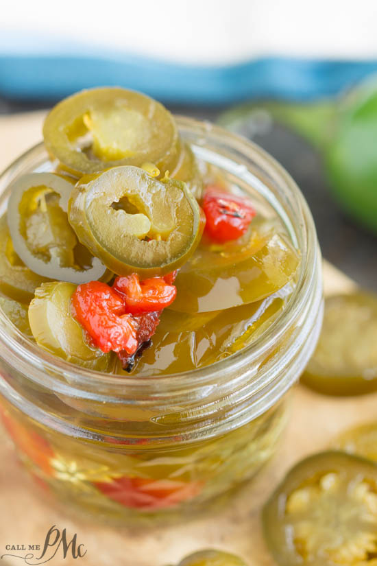 Candied Sweet Heat Pickled Jalapeno Recipe is a tasty combination of sweet, savory, and hot flavors. #jalapenos #pickled #recipe #hot #spicy #easy #canning via @pmctunejones