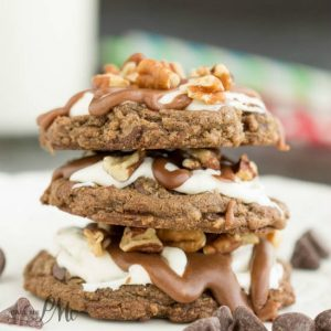 Mississippi Mud Cookies with Marshmallow Fluff and Chocolate Frosting is a delectable fudge cookie recipe topped with creamy marshmallow fluff frosting, rich chocolate ganache, and salted toasted pecans.