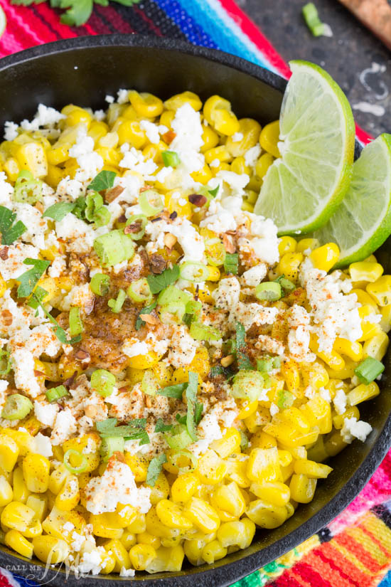 Skillet Mexican Street Corn Recipe is corn off the cobb served Mexican style. It's smothered with a creamy spread and topped with feta cheese, cilantro, and green onions. #corn #streetcorn #recipe #TexMex #feta #butter #easy #sidedish