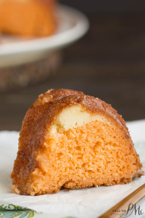 Orange Bundt Cake is tender with a wonderful citrus flavor. It has a ribbon of orange zest filled sweetened cream cheese running through it making it a moist and delicious recipe.