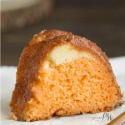Orange Bundt Cake is tender with wonderful citrus flavor. It has a ribbon of orange zest filled cream cheese in it making it a moist & delicious recipe