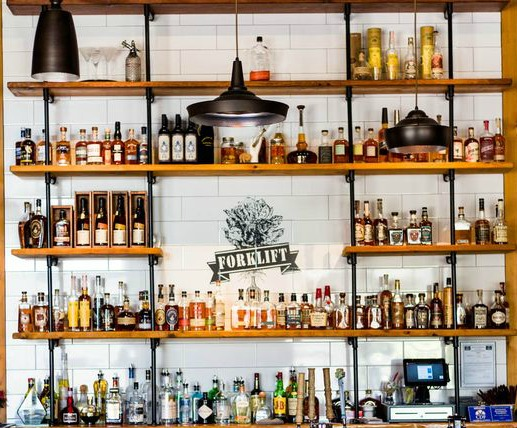 Liquor wall - Local Eats | Forklift Restaurant is a new local restaurant that is making waves for their updated Southern classics using fresh, local ingredients.