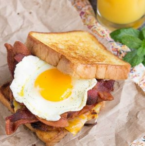 Boy Scout Bacon Hash Brown Breakfast Sandwich recipe is a big, bad breakfast sandwich with all your favorite breakfast foods in one convenient, hand-held package!