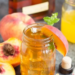Bourbon Peach Tea Cocktail southern inspired flavors of bourbon and peaches. Turn any party into a celebration with this fun and easy drink!