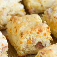 Buttery and flaky these homemade Cheesy Ham buttermilk biscuits are adorned with ham and cheddar cheese. Seriously amazing! This southern style breakfast with homemade biscuits and country ham and gooey cheese is the perfect hearty breakfast! These biscuits are buttery, savory, and a well-deserved treat!