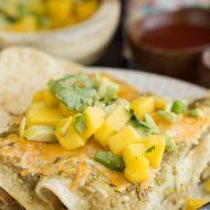 lighter salsa verde chicken enchiladas with avocado mango salsa