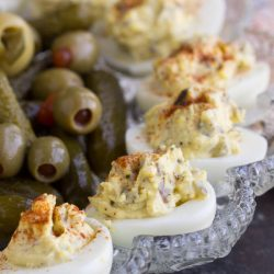 Best Damn Deviled Eggs are creamy and tangy. Classic deviled eggs are easy to make, so delicious, and a flavor bomb appetizer!