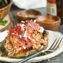 Roasted poblano peppers are stuffed with a hearty meatloaf in this Home-style Meatloaf Stuffed Poblanos recipe. Topped with a rich tomato sauce and tangy feta cheese, this is comfort food at its best.