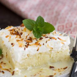 Dessert. A fluffy Tres Leches Coconut Cake soaked with coconut milk, frosted with whipped cream and topped with toasted coconut. A wonderful coconut sponge cake soaks up a trio of milk and makes this an unforgettably luscious dessert.