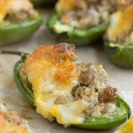 Filled with sausage and topped with cheddar, Baked Fiery Sausage Jalapenos couldn't be a more perfect entertaining appetizer. A simple bite-size appetizer packed with flavor that comes together quickly and easily with just four ingredients.