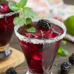 With its' beautiful vibrant color and delicious flavor, Blackberry Lemonade Margarita Smash recipe has fresh summer berries and tart lemonade creating a tasty and refreshing cocktail.