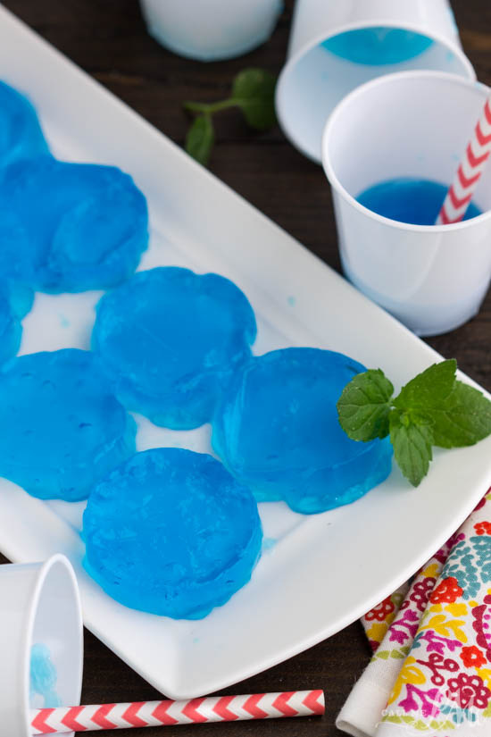 Blue Lagoon Jello Shots are bursting with tropical flavors! They are the perfect party starter for your summer parties! A boozy, summery jello shot recipe that adults love!