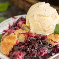 The ultimate Southern summertime dessert, Grandma's Old Fashioned Blackberry Cobbler, has a buttery crust over warm, bubbly, tart blackberries. #blackberry #cobbler #recipe #oldfashioned #Southern #fromscratch #recipes #easy #berry #fruit #crust