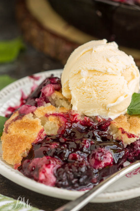 The ultimate Southern summertime dessert, Grandma's Old Fashioned Blackberry Cobbler, has a buttery crust over warm, bubbly, tart blackberries.