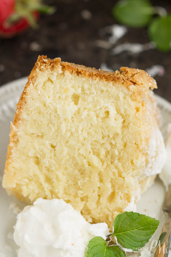 This Coconut Cream Cheese Pound Cake recipe is crazy delicious. Dense and buttery this pound cake is topped simply with a sprinkle of powdered sugar then served with whipped cream and berries. This rich, dense, buttery cake is dessert perfection.