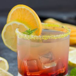 A pretty cocktail, Best Damn Sunset Margarita Cocktail gets it name from the beautiful layered colors. It's fruity and refreshing just what you need to get you through the summer! . drink recipe
