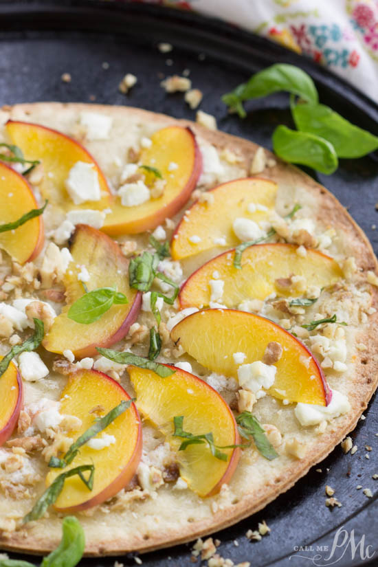 Low-Carb Peach Mascarpone Dessert Flatbread recipe has delicate slices of peaches on a crisp and flavorful cauliflower crust. Then, it's topped with rich mascarpone cheese, goat cheese, walnuts, and basil! A light drizzle of honey finishes off this in-season fruit pizza.