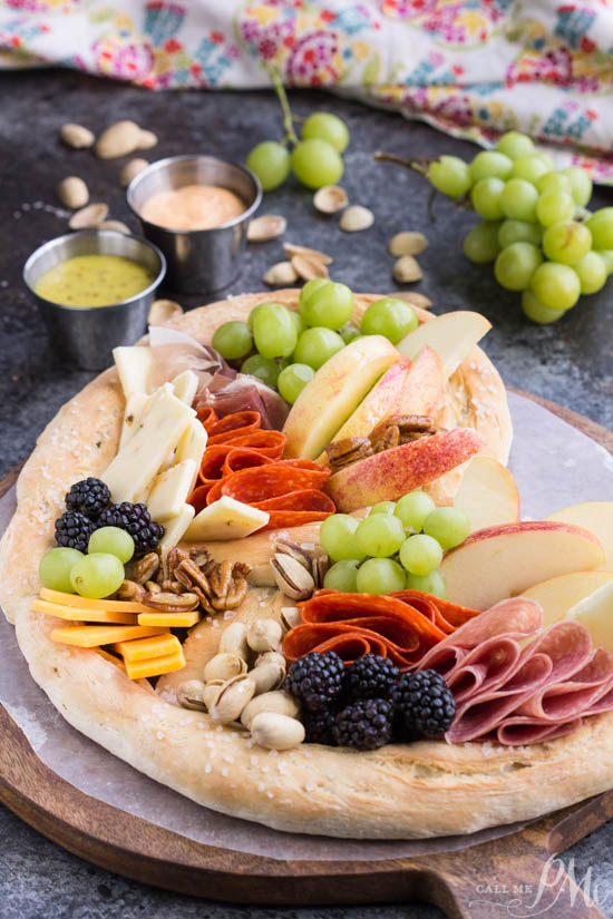 Topgolf Pretzel Board Recipe, a no-fuss party starter, this giant pretzel filled with meats and cheeses provides endless grazing and is always a crowd-pleaser. It's a nice twist on a classic charcuterie board.
