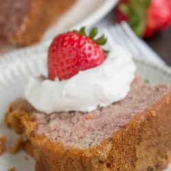 Real Fruit Strawberry Buttermilk Pound Cake (No Jello or Kool-Aid) is a delightful strawberry pound cake made with condensed fresh strawberries. It's luscious and soft, yet not too sweet, and bursting with fresh strawberry flavor.