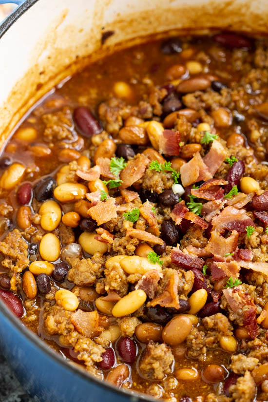 Stovetop Bourbon Bacon and Sausage Baked Beans -Hearty, flavorful, nutritious, and healthy, Stovetop Bourbon Bacon and Sausage 'Baked' Beans recipe thick and meaty. They make the perfect complement to your game day table, potluck, or barbecue all year.