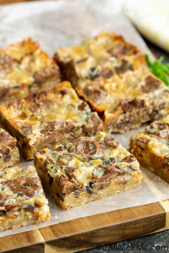 Pecan Shortbread Toffee and Rolo Magic Cookie Bars, whether you call them Magic Cookie Bars, Hello Dolly Bars, or Seven Layer Bars this ooey, gooey dessert recipe is sure to please! They are always a crowd-pleaser and always hit the spot!