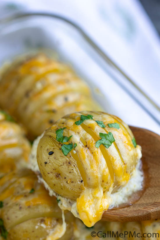 An easy and delicious recipe for cheesy, garlicky, crazy-delicious Hasselback Scalloped Potatoes. They are the perfect side dish for a family dinner!