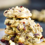 Big bakery-style cookies, Texas Ranger Cookies with Cranberries, has the flavor of the season. These melt-in-your-mouth cookies are super easy to make and insanely delicious!