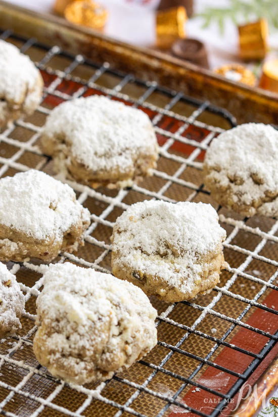 Hidden Rolo Snowball cookies, a hidden Rolo chocolate and caramel candy make this cookie a sweet surprise. This is a fun cookie recipe alternative.