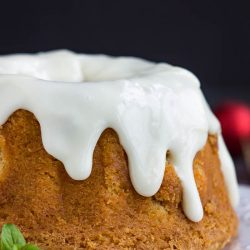 A moist Best Sweet Potato Pound Cake with Cream Cheese Frosting is highlighted by a cinnamon, cloves, and topped with cream cheese glaze.