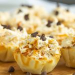 No-Bake Butterfinger™ Cheesecake Tarts recipe is a creamy no-bake pie with Butterfinger candy in a pre-made tart shell.