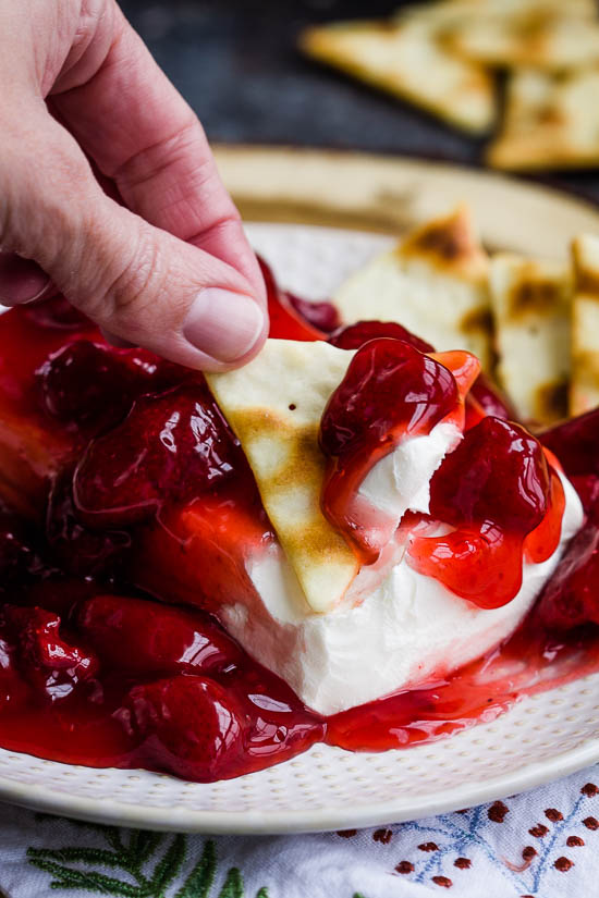There could not be a more simple recipe than Strawberry Block Cream Cheese Spread. With just two ingredients this recipe comes together in minutes. It's great for the holidays and always a crowd-pleaser!