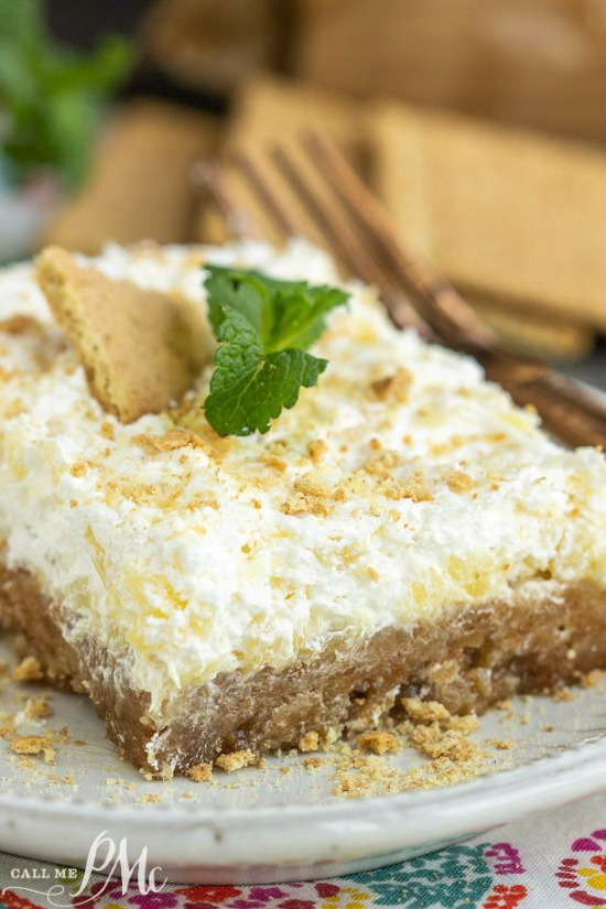 This Hawaiian Pineapple Delight Dessert Recipe is rich but light. It has a graham cracker bottom and a refreshing pineapple spiked whipped topping layer.