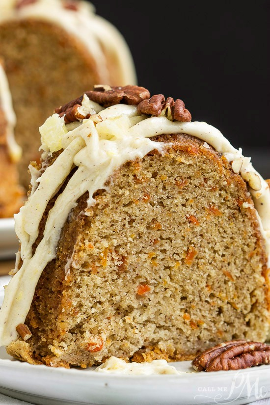 This incredibly tender and moist Blue Ribbon Roasted Carrot Pound Cake with Pineapple Mascarpone Frosting Recipe is the best carrot cake you'll ever make! #cake #poundcake #carrotcake #Eastercake #springcake