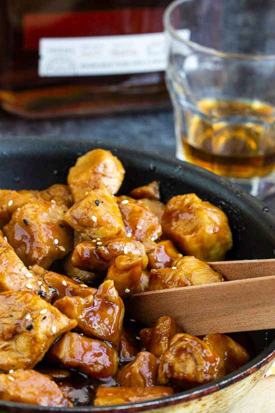 Recipe. Spicy and sweet, Copycat Cajun Cafe Bourbon Chicken Bites are tender chunks of chicken cooked in a bourbon and brown sugar sauce. #appetizer #entree #recipe #chicken